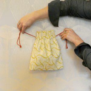 St Peter printed drawstring bag, in mustard